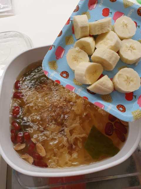 Adding Banana to White Fungus Banana Sweet Dessert