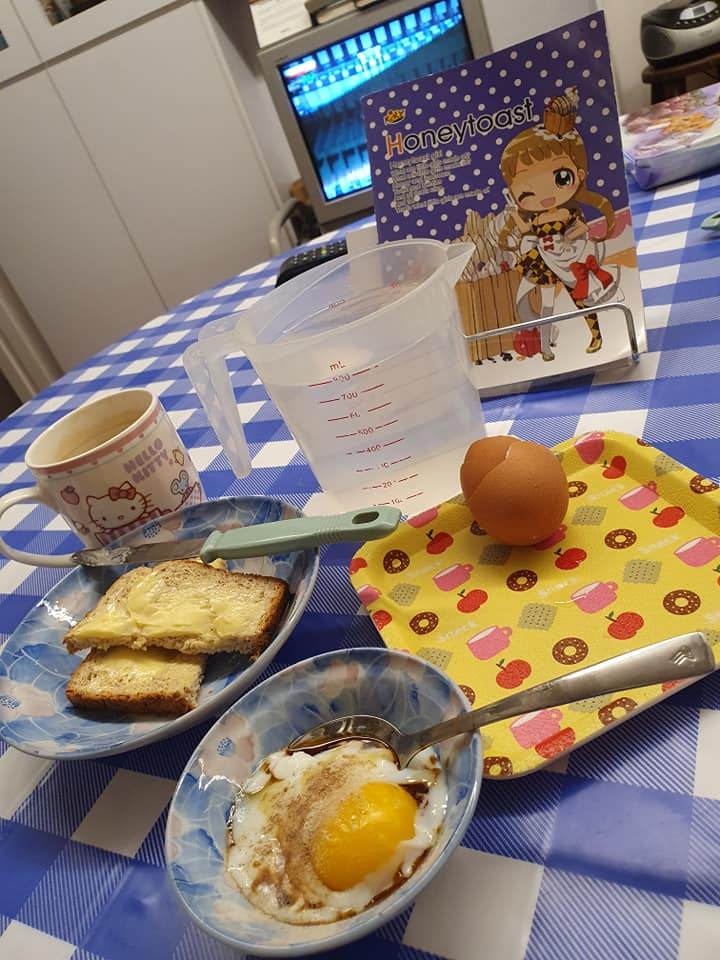 My Breakfast set: 8.5 min Half Boiled Egg, Toasted Bread with Butter, a cup of Nescafe Gold with Milk without Sugar