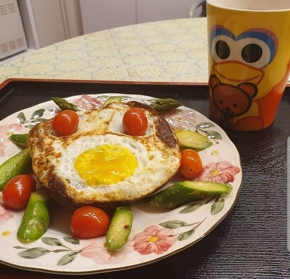 Fried Egg with self made bread on bed of Asparagus & Cherry Tomatoes, one cup Nescafe Gao Siew Dai