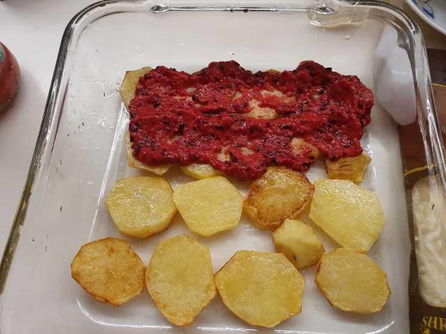 Layer potatoes with BARILLA Brand Basilico Sauce on top